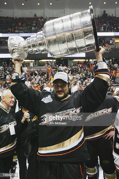 Teemu Selanne of the Anaheim Ducks hoists the Stanley Cup after his team's victory over the Ottawa Senators during Game Five of the Stanley Cup...