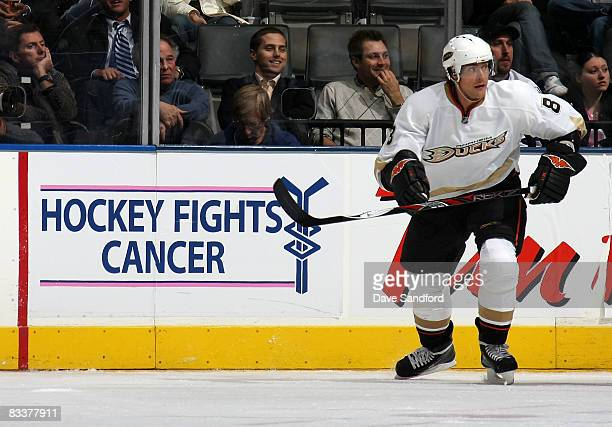 Teemu Selanne of the Anaheim Ducks skates against the Toronto Maple Leafs with the Hockey Fights Cancer logo in the background during their NHL game...