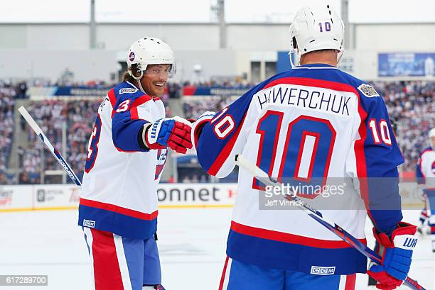 Teemu Selanne of the Winnipeg Jets alumni celebrates a goal with teammate Dale Hawerchuk during the 2016 Tim Hortons NHL Heritage Classic Alumni Game...