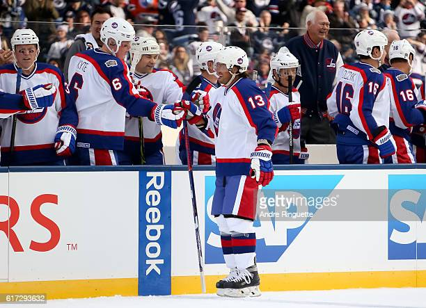 Teemu Selanne of the Winnipeg Jets alumni high fives the bench after scoring a first period goal on Edmonton Oilers alumni during the 2016 Tim...