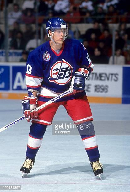 Teemu Selanne of the Winnipeg Jets skates on the ice during an NHL game circa 1992.