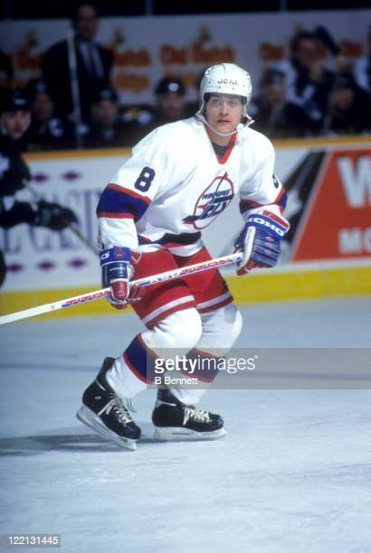 Teemu Selanne of the Winnipeg Jets skates on the ice during an NHL game against the Dallas Stars circa 1995 at the Winnipeg Arena in Winnipeg,...
