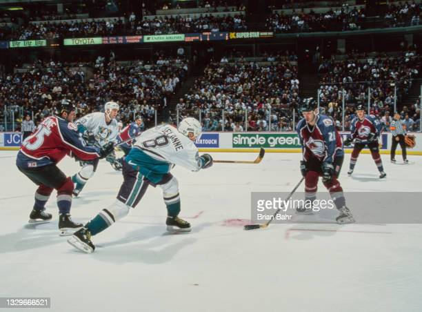 Teemu Selanne, Right Wing for the Mighty Ducks of Anaheim takes a shot past Stephane Yelle of the Colorado Avalanche during their NHL Western...