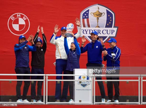 Teemu Selanne, Tom Felton, Toni Kukoc, Stephanie Szostak, Sasha Vujacic, and Alessandro Del Piero celebrate with the trophy after winning the...