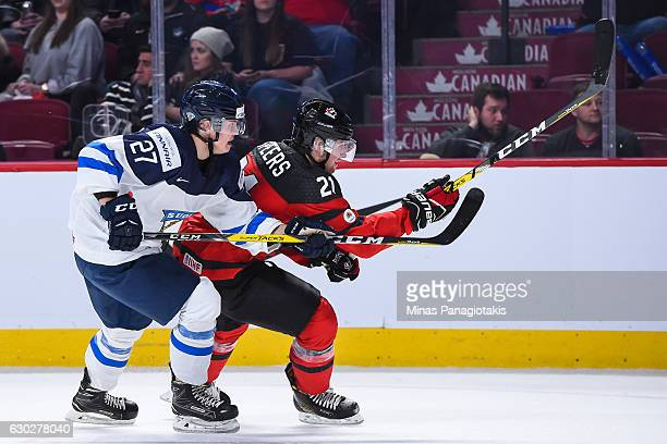 Teemu Vayrynen of Team Finland and Blake Speers of Team Canada skate against each other during the IIHF exhibition game at the Bell Centre on...