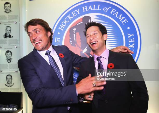 Teemus Selanne and Paul Kariya pose for photos during a media opportunity at the Hockey Hall Of Fame and Museum on November 10 2017 in Toronto Canada