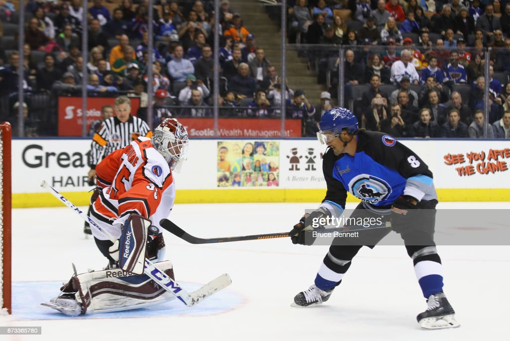 Teemus Selanne #8 skates in and is stopped by J.S. Giguere #35 during the shootout at the Legends Classic game at the Air Canada Centre on November 12, 2017 in Toronto, Canada.