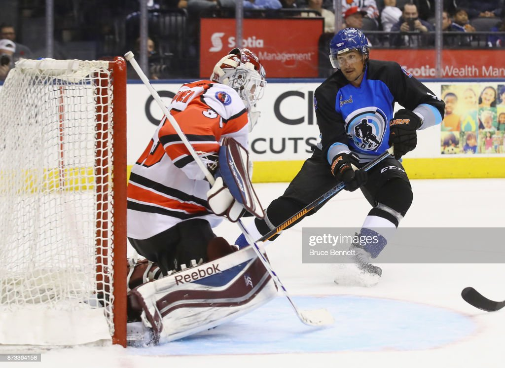 Teemus Selanne #8 skates in on J.S. Giguere #35 during the Legends Classic game at the Air Canada Centre on November 12, 2017 in Toronto, Canada.