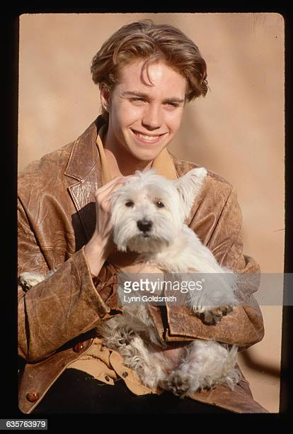 Teen actor Jonathan Brandis hold a West Highland white terrier
