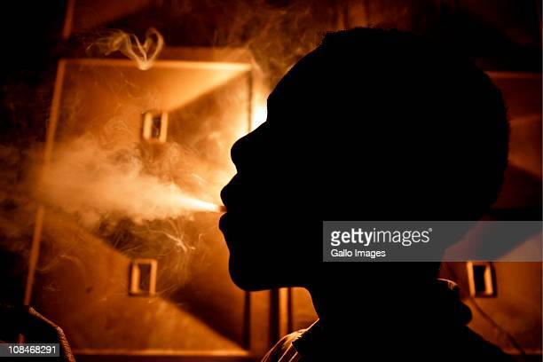 A teen addict smokes whoonga in a drug den in KwaDabeka township on July 22 2010 in Pinetown near Durban South Africa This new deadly and highly...