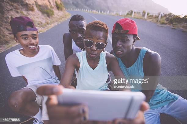 Teen African American girl taking selfie of herself and friends