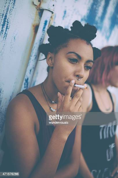teen afro girl smoking on the street - little girl smoking cigarette stock photos and pictures