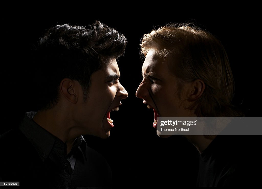 Teen Boy and Adult Male Yelling : Stock Photo