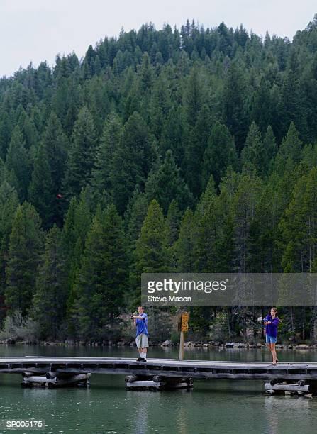 Teen Boy and Girl Fishing