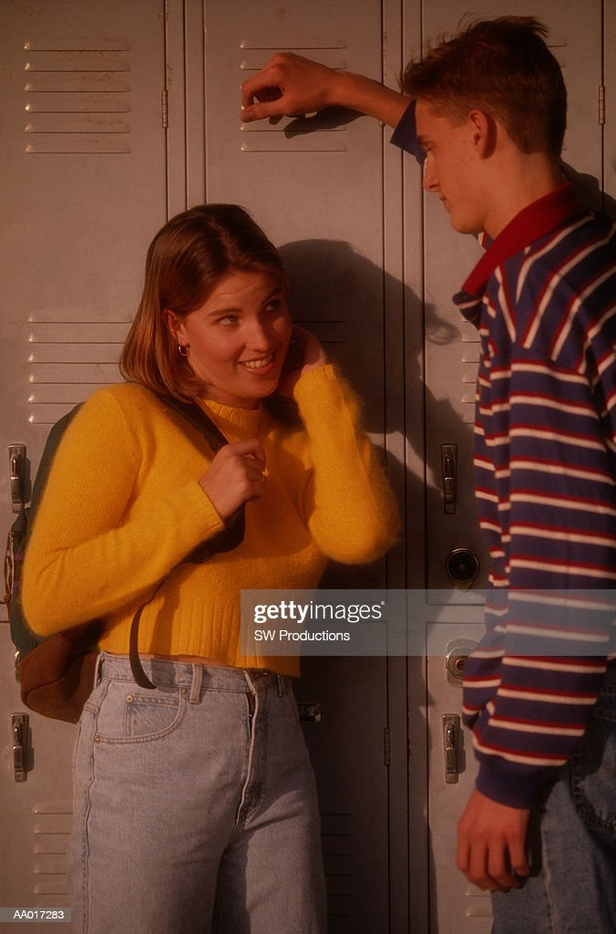 Teen Boy and Girl Flirting : Stock Photo