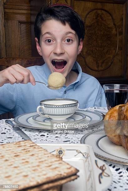 Teen Boy Eating Mazto Ball Soup