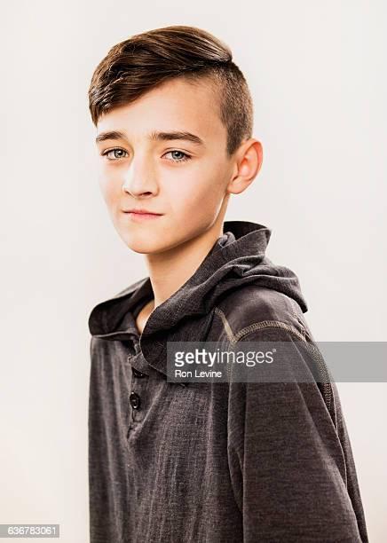 Teen boy, portrait on white