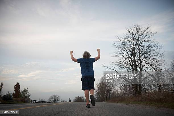 Teen boy reaching top of hill
