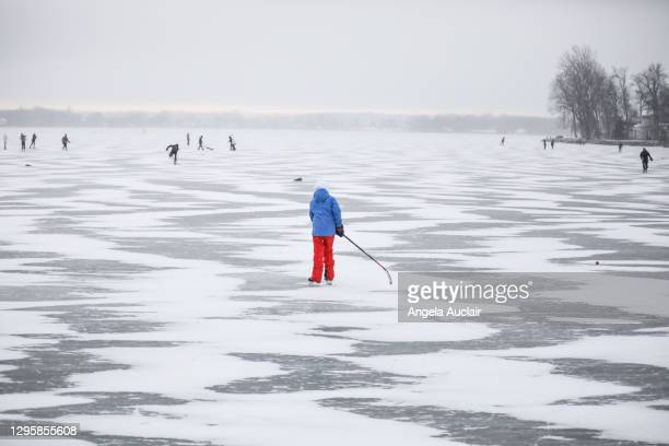 teen boy skates on winter lake - angela auclair stock pictures, royalty-free photos & images