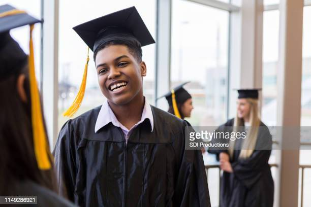 teen boy smiles and laughs with friend - high school graduation stock pictures, royalty-free photos & images