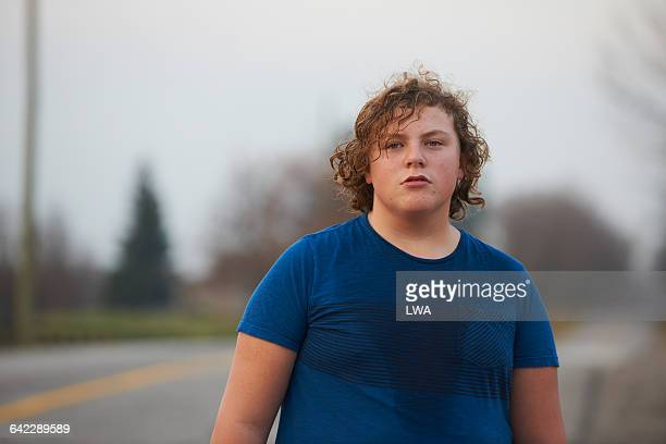 teen boy sweating after workout - chubby boy stock photos and pictures