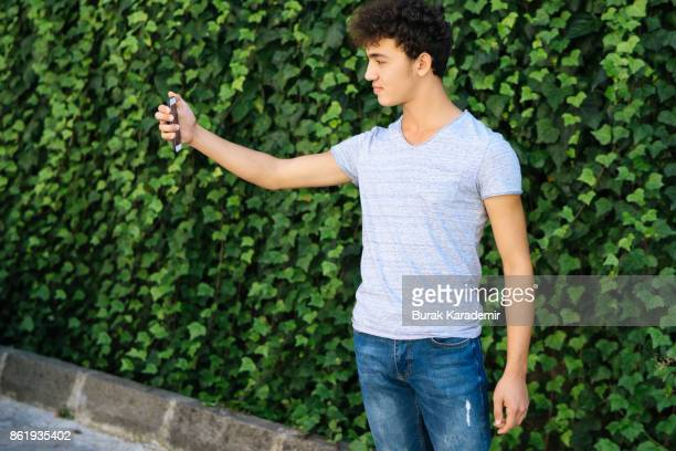 Teen Boy Taking Selfie Smiling