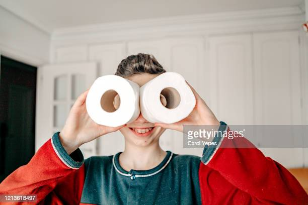 teen boy using toilet paper as binoculars - funny toilet paper imagens e fotografias de stock