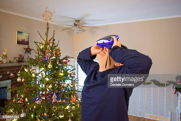 Teen boy using VR viewer at Christmas