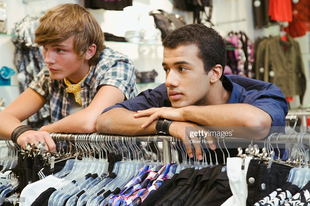 Teen boys in clothing store : Stock-Foto