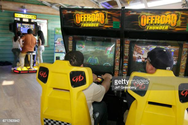 Teen boys playing on a Offroad Thunder simulator at Zao Island Entertainment Center