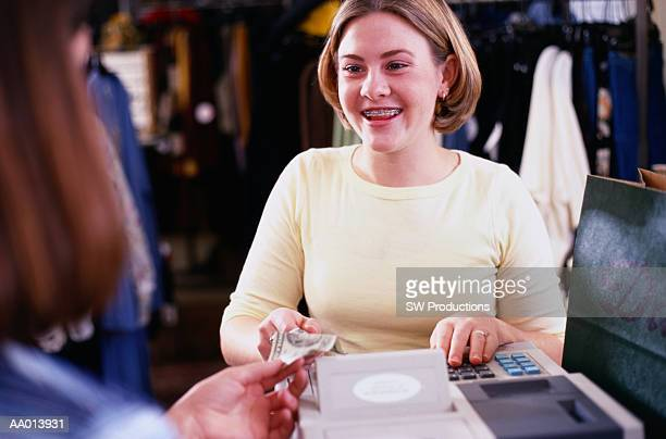 Teen Cashier at a Clothing Store
