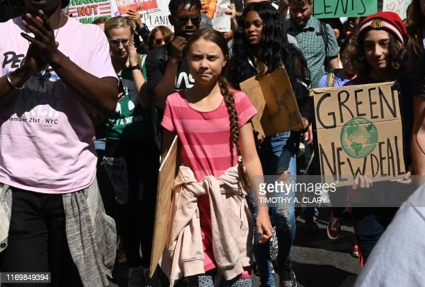 Teen climate activist Greta Thunberg walks with protesters during the Global Climate Strike march in New York September 20, 2019. - Crowds of...