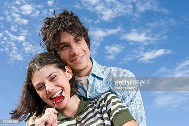 Teen couple hugging