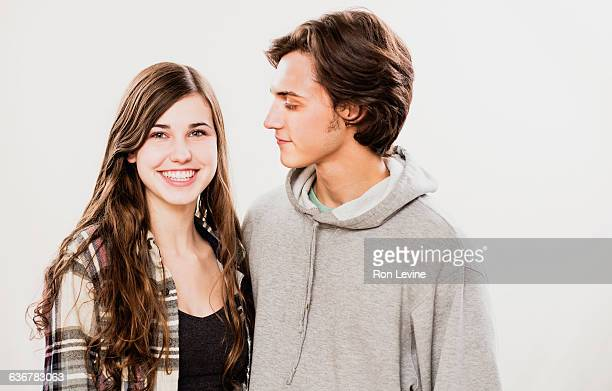 Teen couple, portrait on white