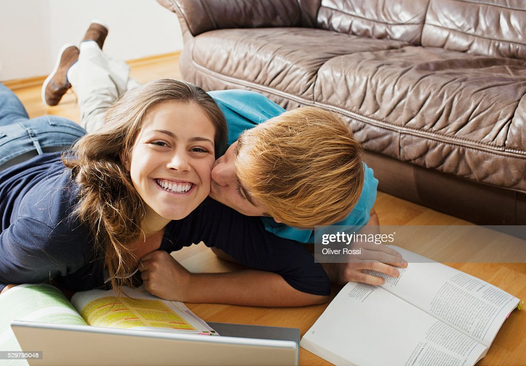 Teen (16-17) couple studying at home : Stock Photo