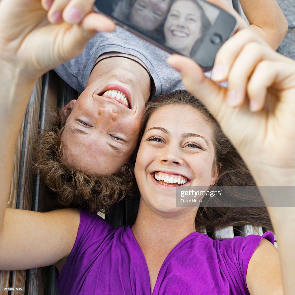 Teen (16-17) couple taking self-portrait photo : Stock Photo