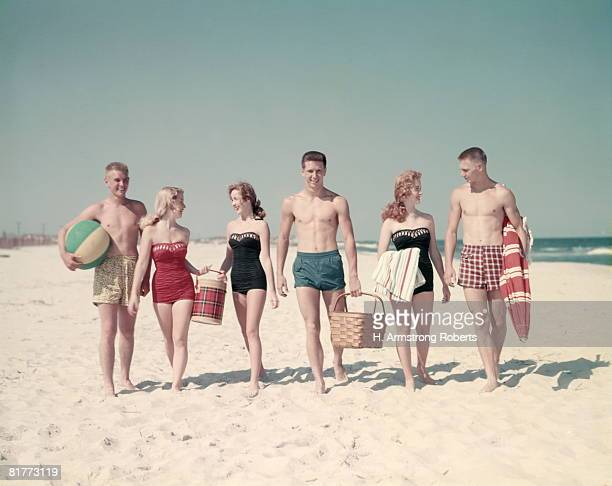 3 Teen Couples 6 People Walking In A Line Down Beach Summer Carry Basket Thermos Beach Ball Towels Umbrella.