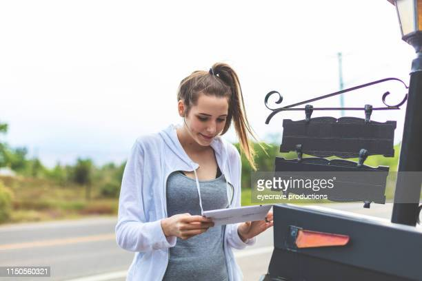 Teen Female Receiving Application for University Acceptance by Mail Excited About The Future