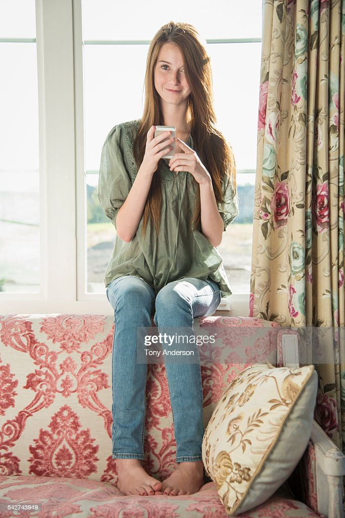 Teen Girl At Home With Phone Stock Photo - Getty Images-4564