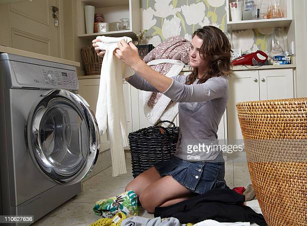 Teen girl checking laundry instructions in garment