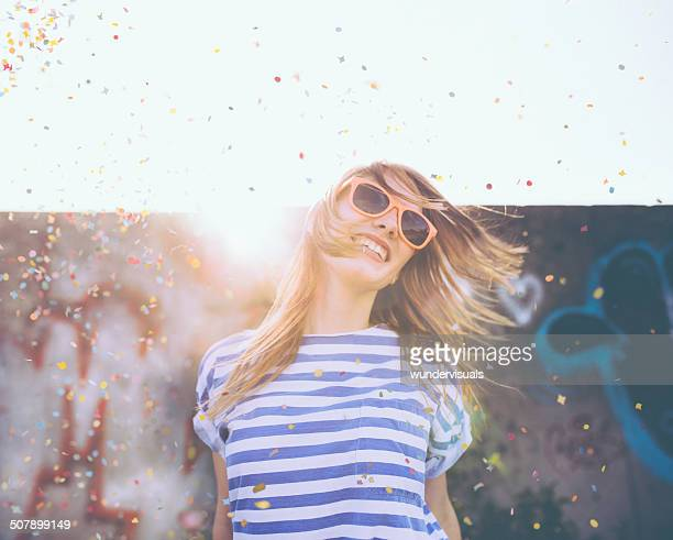 Teen Girl Dancing in Confetti