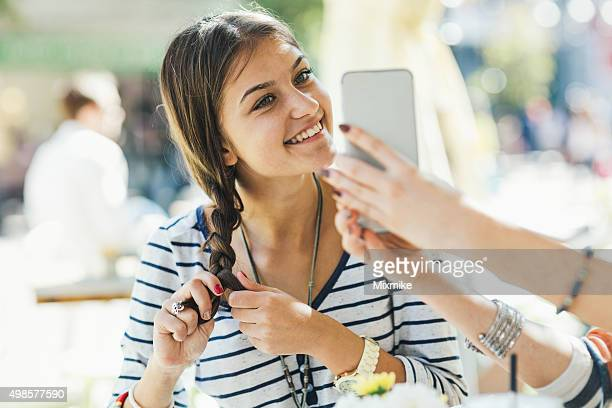 teen girl fixing her hair - girl in mirror stock photos and pictures