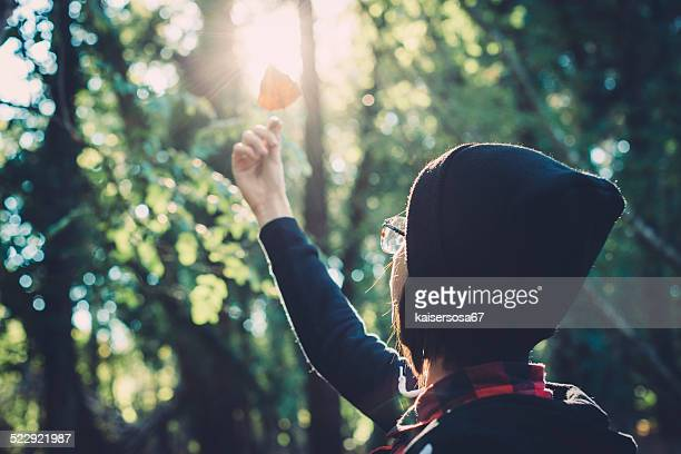 teen girl holding a leaf - ecologist stock pictures, royalty-free photos & images