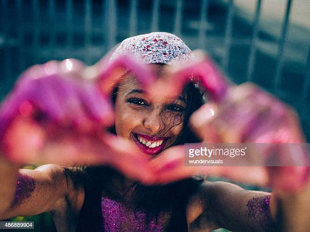 teen girl holding her hands in a heart shape - magenta stock pictures, royalty-free photos & images