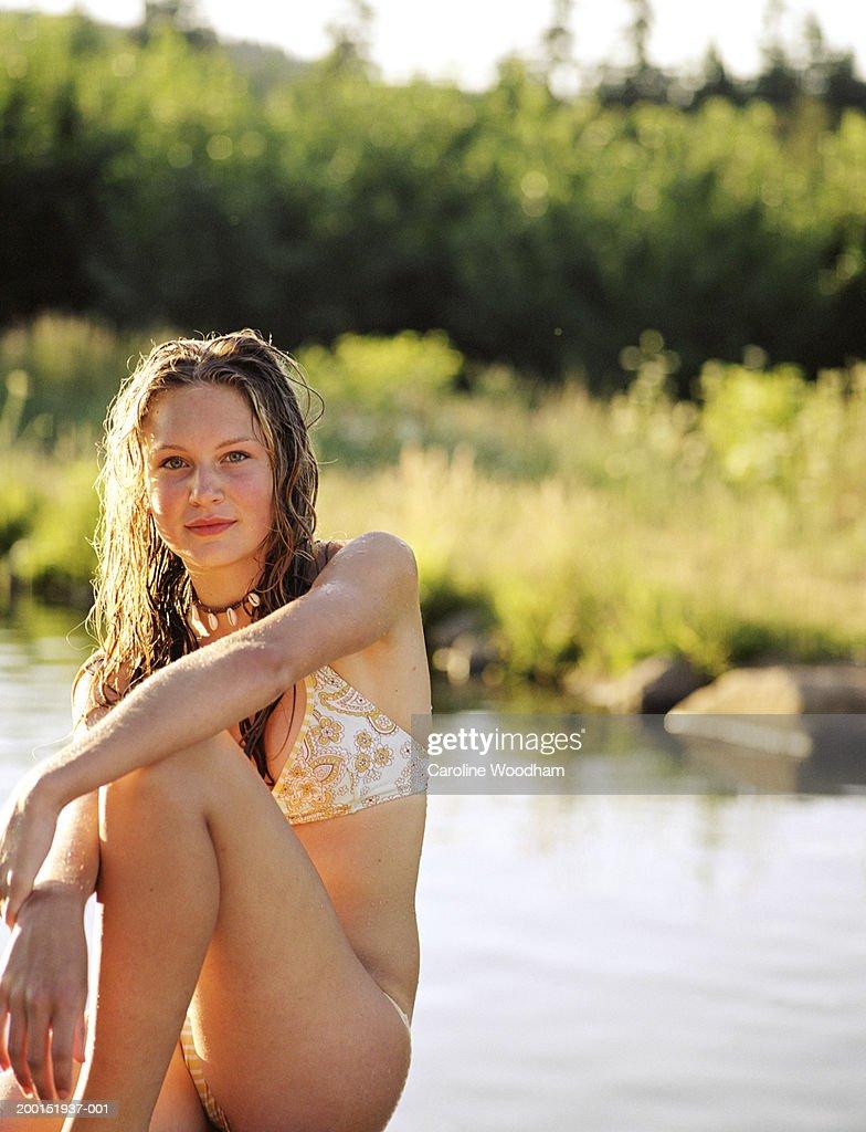 Teen Girl In Bikini Sitting Beside Pond Portrait Stock