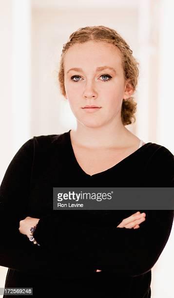 Teen girl in black sweater, portrait