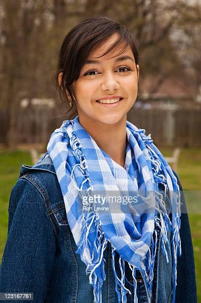 Teen girl in blue scarf, portrait