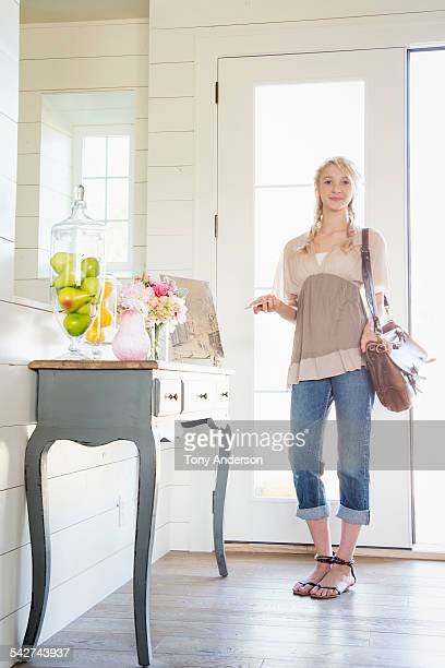 teen girl in entry way at home - idaho falls stock photos and pictures