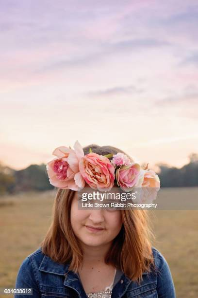 Teen Girl In Floral Crown At Sunset
