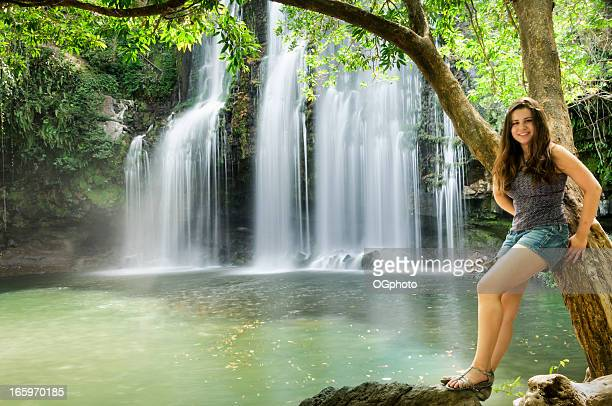 Teen girl in front of a waterfall
